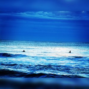 Surfers at six-thirty a.m. Ocean City, Maryland.